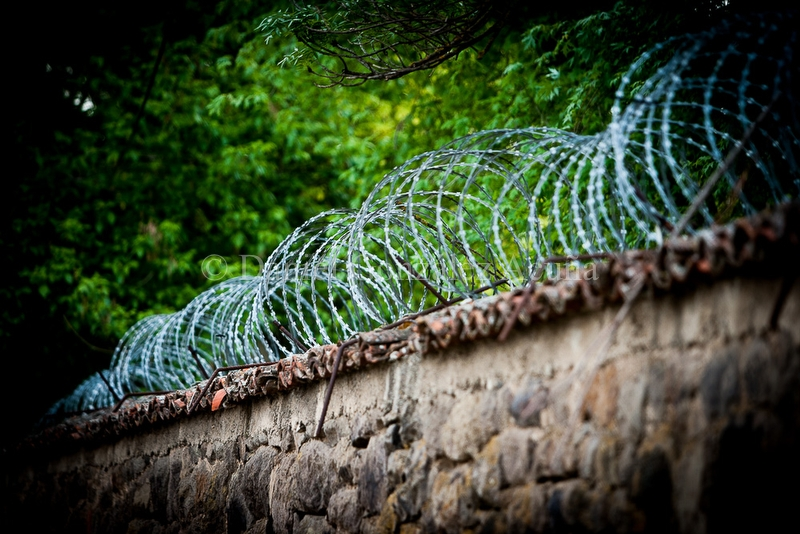 Barbed wire on the wall of the monastery of Gracanica